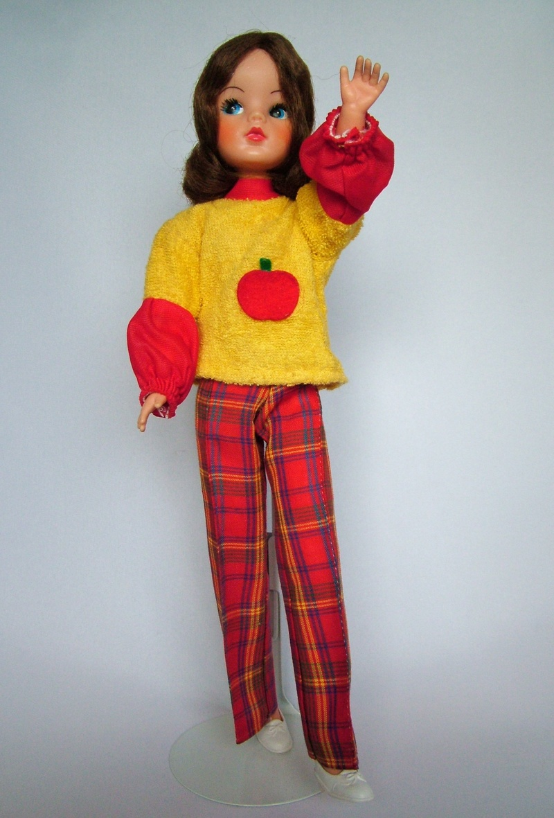 """478ac88a992 Described as """"ready to go to a swinging party"""" this Sindy wore a top and  trousers. The all-in-one top was very fashionable at the time and was  designed to ..."""